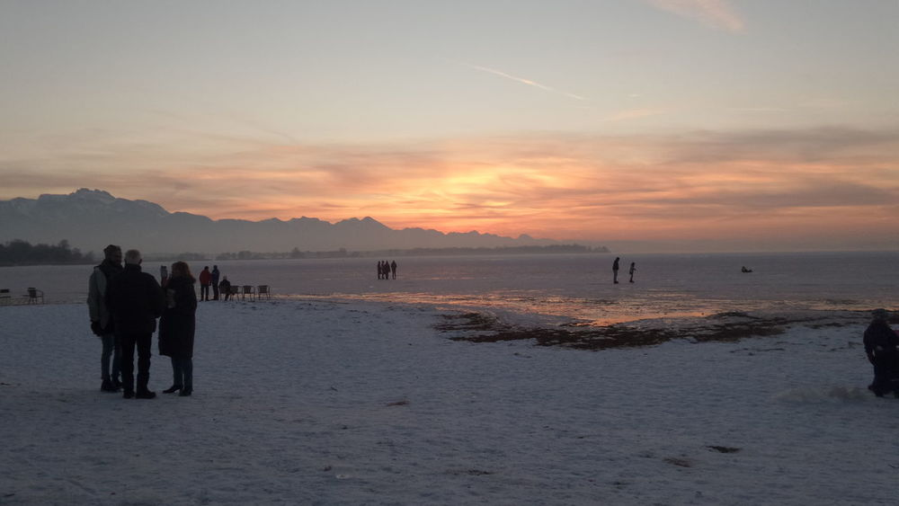 Sunset Beach Lakeview Outdoors Beauty In Nature Silhouette Mountain Range People On Ice Magic Moments