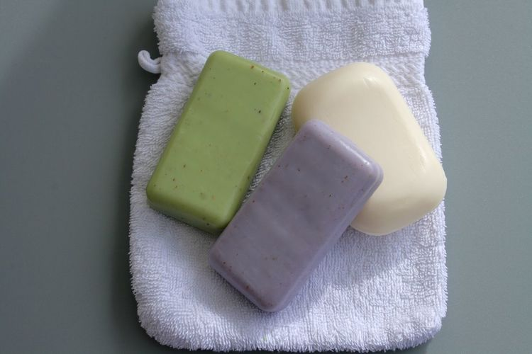Directly above shot of soap bar on towel