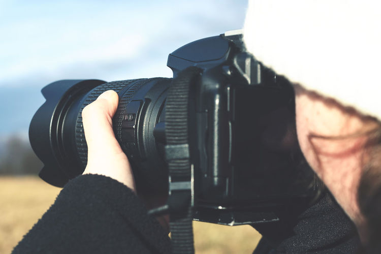 Close-up of woman photographing from camera