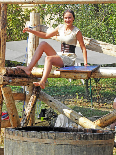 Renaissance Festival,Koprivnica 2016, girl who falls in water, 31 Annual Barrel Croatia Day Eu Europe Event Fair Falling Into Water Full Length Funny Game Girl Koprivnica Medieval Outdoors Person Pretty Girl Renaissance Festival Sitting Summer Traditional Wood - Material Wooden Young Adult