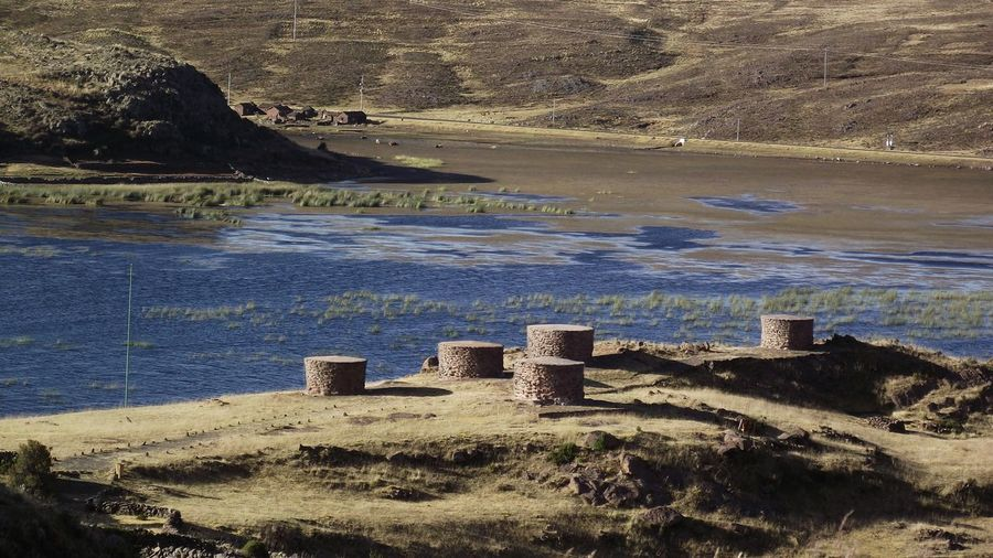 Ancient Beauty In Nature Chulpas Puno Day Grass La Landscape Mountain Nature No People Outdoors Scenics Sky Water