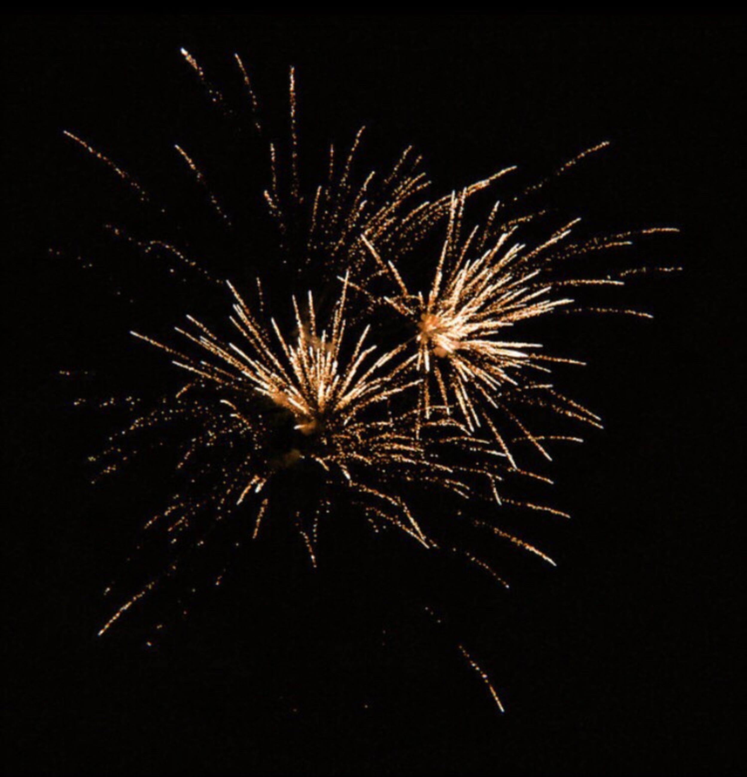 firework display, firework - man made object, exploding, celebration, sparks, night, arts culture and entertainment, long exposure, motion, event, low angle view, no people, illuminated, explosive, outdoors, sparkler, sky, firework, diwali, black background