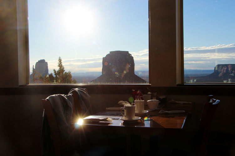 Window Sky Sunlight Food And Drink Lens Flare Table Nature Indoors  Day Glass - Material Transparent Lifestyles Sunbeam Sitting Sun Drink Food Refreshment Architecture Plant No People Glass Monument Valley Breakfast Arizona