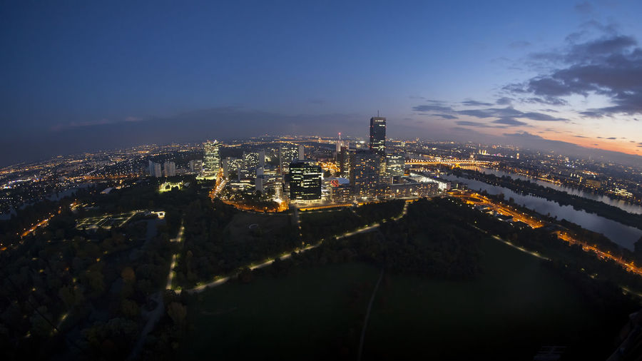Scenery Vienna by night Danube Lights Vienna Angle Architecture Birds Eye View Blue Building Exterior Built Structure City Cityscape Curved  Fish Eye Fisheye High Angle View Horizon Illuminated Night No People Outdoors River Sky Skyscraper Travel Destinations Wide