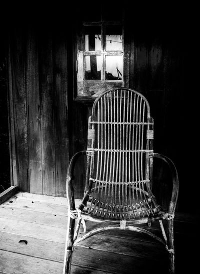 Old and lonely. Worn out old rattan chair in village in Malaysia Chair Rattan Chair Lonely Old Monochrome Abandoned No People Empty Poor  Home
