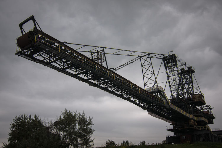 Brown Coal Mine Architecture Bridge - Man Made Structure Brown Coal Surface Mining Area Built Structure Cloud - Sky Construction Machinery Crane - Construction Machinery Day Development Ferropolis Industry Low Angle View Machinery Metal Mining No People Open-cast Mining Outdoors Sky Transportation