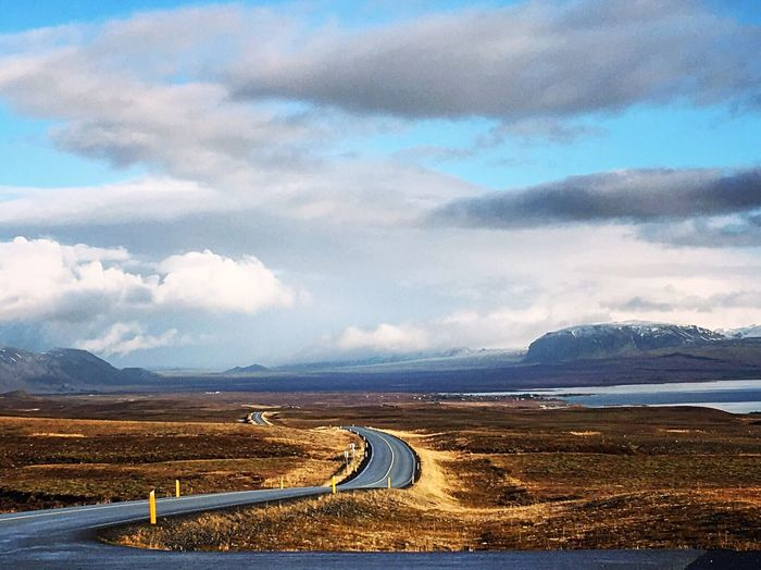Best way to explore Iceland is to just get in a car and go. You will not regret it! Iceland Tranquility Mountain Road Sky Mountain Range Landscape Outdoors Winding Road Transportation Beauty In Nature No People Scenics Curve Nature Mountain Road Day Travel Destinations Enjoying The View Roadtrip Discover The World Adventure Finding New Frontiers Miles Away Miles Away