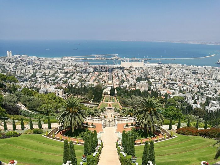 Baha I Gardens Against Terraces Of The Shrine Of The Bab Amidst City