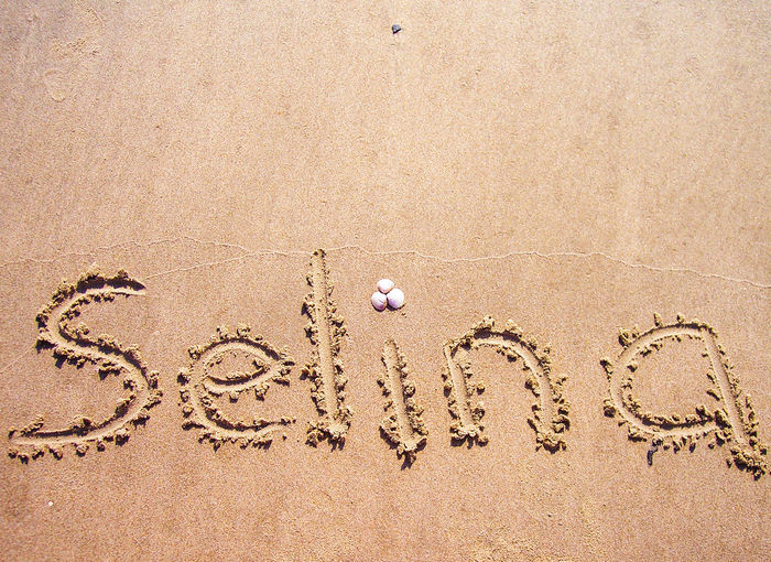 Written In The Sand Selina Name In The Sand Sand Dune Beach Sand Pattern Backgrounds Full Frame