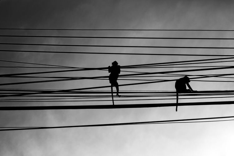 monkeys b&w Connection Silhouette Cable Sky Real People Electricity  Power Line  Low Angle View Men Two People People Nature Power Supply Full Length Technology Fuel And Power Generation Outdoors Standing Metal Lifestyles Complexity