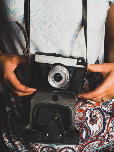 Midsection of man photographing