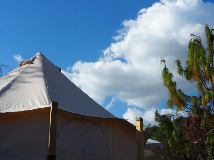 Low angle view of tent on building against sky