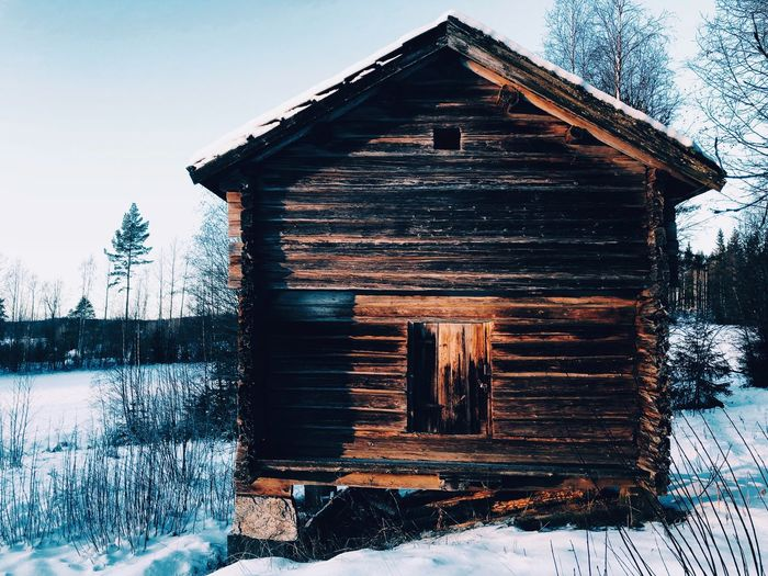 View of wooden house in winter