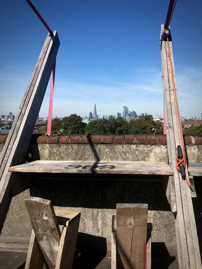 Construction site by bridge against sky