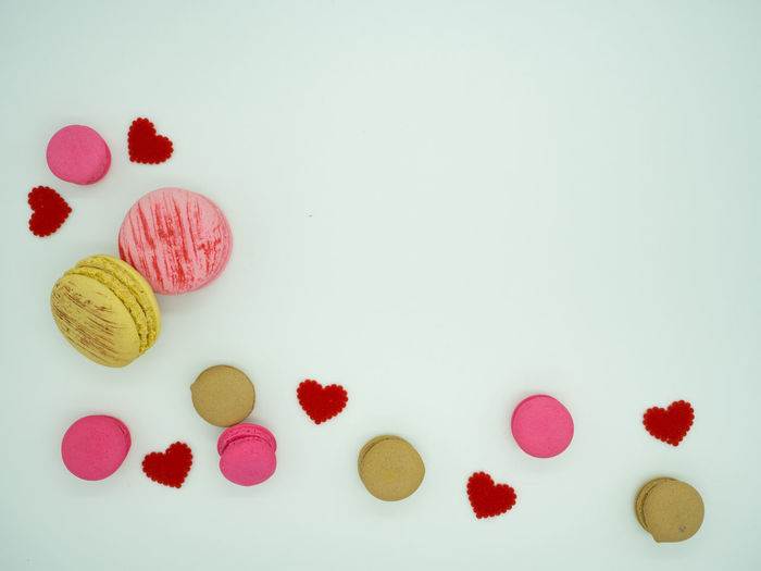 Sweet cake macaron and colorful almond macaron cookies on white background with copy space for text. Almond Background Bake Bakery Biscuit Colorful Cookie Cream Food France Gift Macarons Retro Romantic Row Snake Stacked Sugar Sweet Valentine