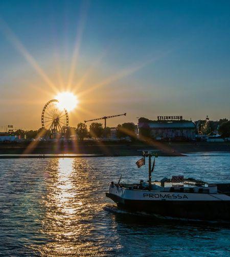 Promessa Sun Sunset Sunlight EyeEm Selects Water Nautical Vessel City Sunset Sunlight Urban Skyline Sky Tourboat Water Vehicle