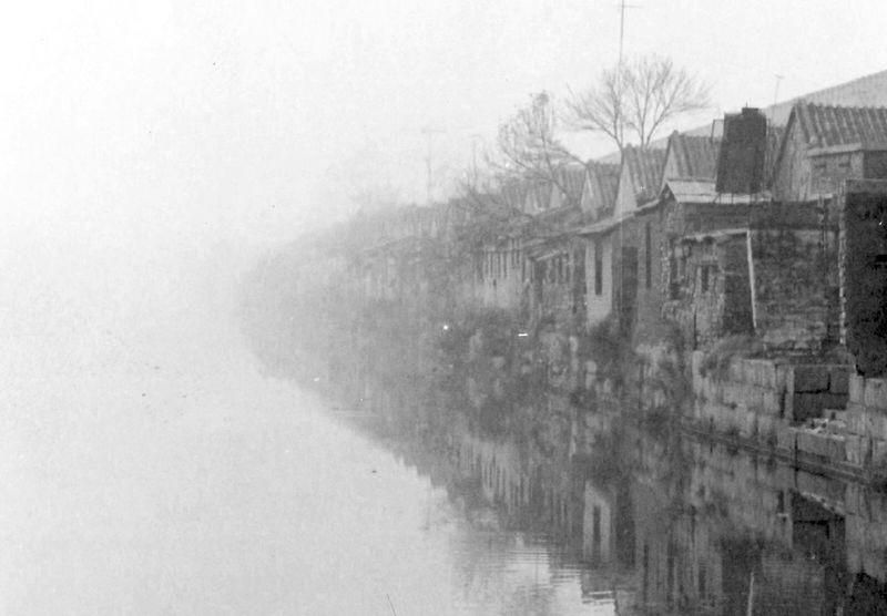 A scene in Beijing, China in the late 80's. This is a very ancient houses behind the Forbidden City of China. Happy Morning Beautiful Morning Beijing Forbidden City Misty Misty Morning Film Photography Beijing Scenes Black And White Monochrome