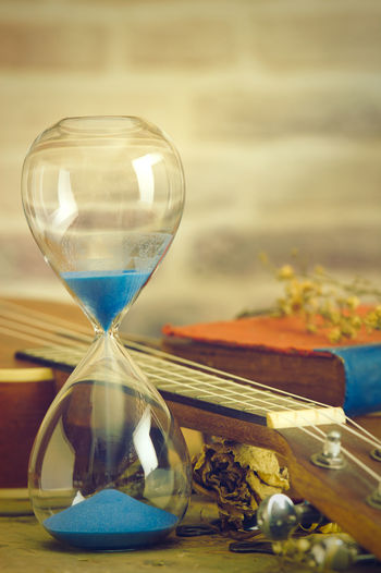 Close-up of clock on table at beach