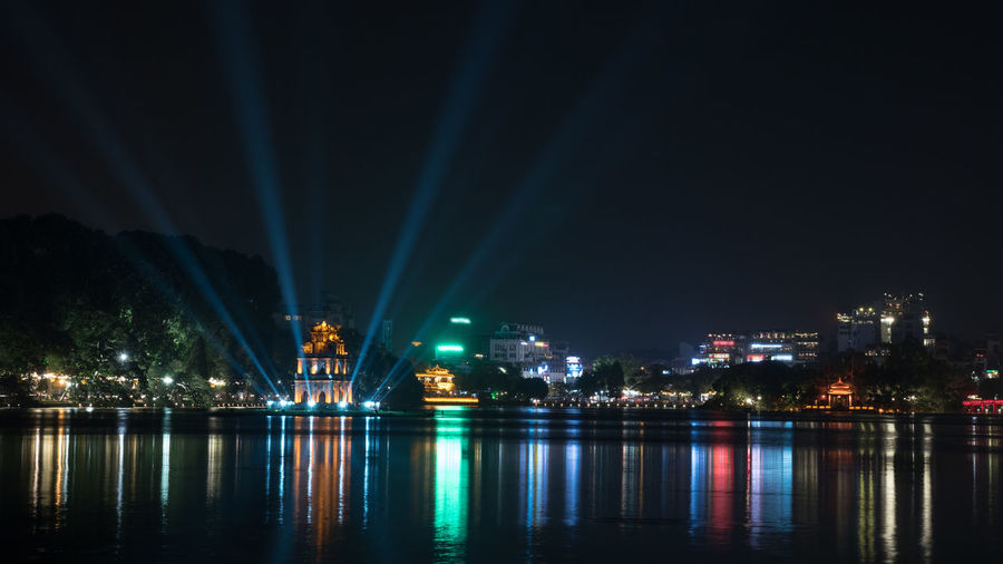 Hanoi view at night with illuminated Turtle Tower and Hoan Kiem Lake in city centre. Colorful lights reflecting in dark water Architecture ASIA Blue City Colorful Hanoi Hoan Kiem Lake Horizontal Illuminated Night Nightlife Outdoors River Sight Sky Sword Lake Travel Vietnam View Water