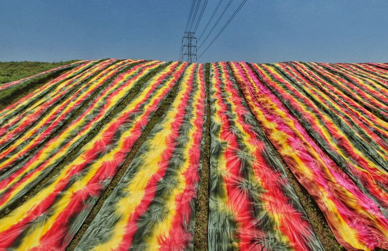 sunny day is perfect day for hanging fabric in the home industry area, Sukoharjo, Central Java Fashionindustry Colored Fabric Fabric Fashion Industry Home Industry Rural Scene Multi Colored Sky Landscape Tranquil Scene Calm Countryside Non-urban Scene
