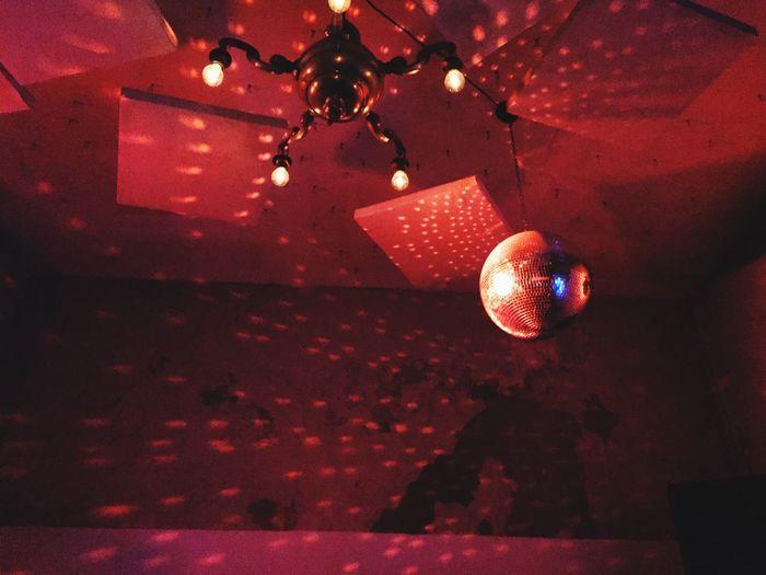 Disco ball lights reflecting on wall