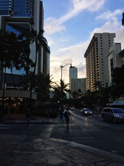 Walking the streets Architecture Built Structure City Building Exterior Sky Street Transportation Building Motor Vehicle Road Real People Cloud - Sky City Life City Street