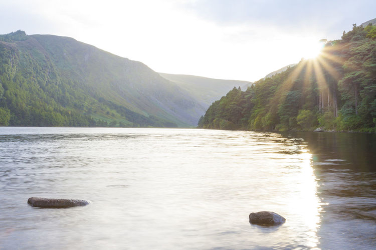 Landscape in lake of Glendalough in wicklow mountain, Ireland Mountain Water Beauty In Nature Scenics - Nature Tranquility Sky Tranquil Scene Nature Lake Non-urban Scene Day Waterfront No People Sunbeam Idyllic Sunlight Remote Mountain Range Outdoors