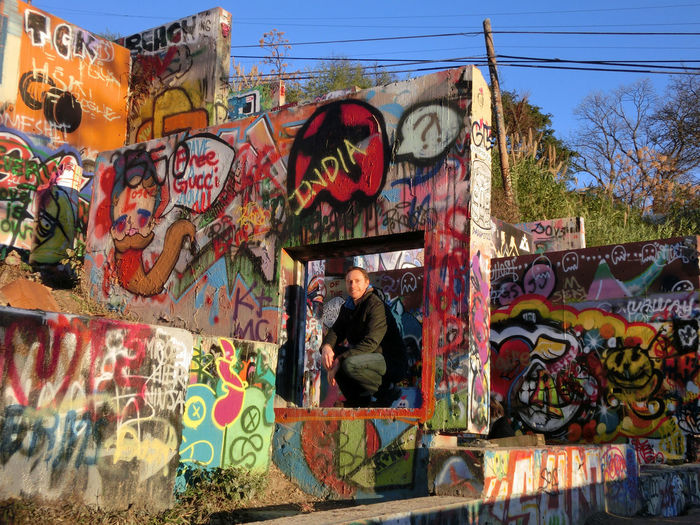 Adult Adults Only Architecture Artist Building Exterior Built Structure City Day Full Length Graffiti Lifestyles Low Angle View Men Multi Colored One Man Only One Person Only Men Outdoors People Real People Sky Street Art Tree
