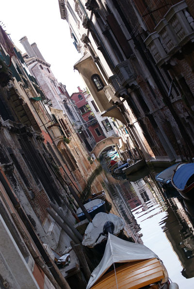Reflection in canal. Architecture Building Exterior Built Structure City Day Inclined No People Not Straight Outdoors Waiting Waiting In Line EyeEmNewHere Adapted To The City Betterlandscapes The City Light Traditional Boat Traditional Boats The Street Photographer - 2017 EyeEm Awards