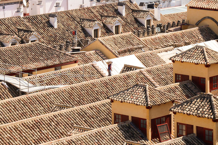 Construction on rooftops Architecture Built Structure Roof Building Exterior Building Residential District High Angle View Roof Tile House Day City No People Sunlight Outdoors Nature Community Town Modern