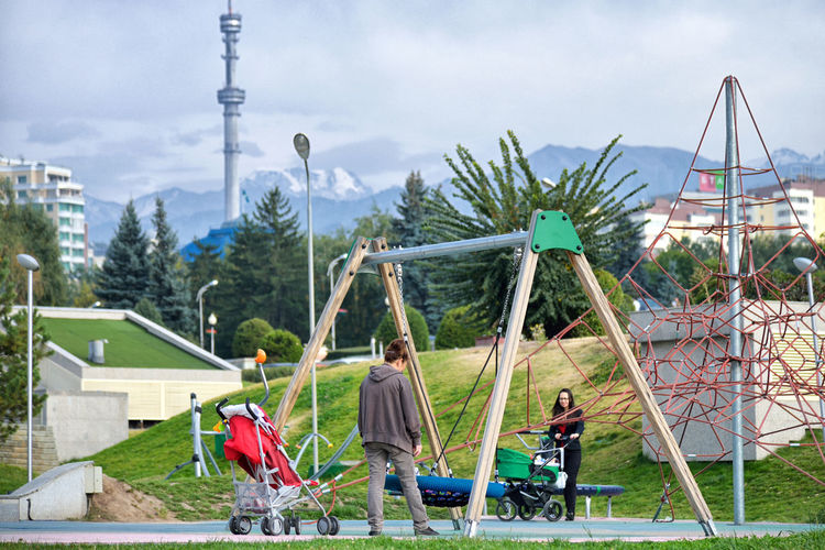 Childhood at the Root of Mountains Almaty Almaty, Kazakhstan Children City Kazakhstan Travel Group Of People Mountains Outdoors People Playground Sky #urbanana: The Urban Playground Streetwise Photography