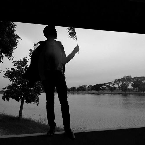Black & White Sky Alone One Man Only Silhouette Only Men Men Lake People Full Length One Person Adult Human Body Part Beach Adults Only Outdoors Day First Eyeem Photo