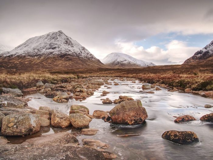 Cold day on meadow at river coupall at delta to river etive near glencoe in the scottish highlands