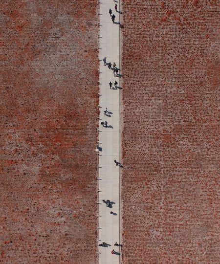 Aerial view of people on footpath