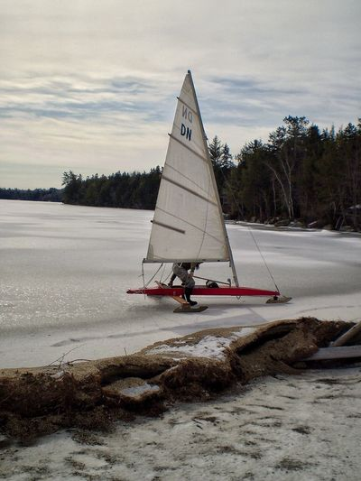 Outdoors Day Pond Ice Boat Fun Recreation  Sport Winter Nautical Vessel Transportation Nature Sky Sailboat Sea Sailing Scenics Cold Temperature Water Real People One Person Mollasses Pond Eastbrook, ME Tourist Destination