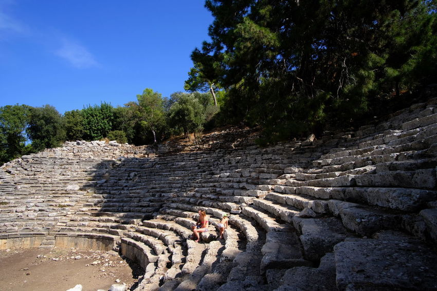 Phaselis (Greek: Φασηλίς) was an ancient Greek and Roman city on the coast of Lycia. Its ruins are located north of the modern town Tekirova in the Kemer district of Antalya Province in Turkey. It lies between the Bey Mountains and the forests of Olympos National Park, 16 kilometres (9.9 mi) south of the tourist town of Kemer and on the 57th kilometre of the Antalya–Kumluca highway. Phaselis and other ancient towns around the shore can also be accessed from the sea by daily yacht tours. Source: Wikipedia Turkey Antalya Kemer Olimpos, Kemer Phaselis Antik Kent Sehenswürdigkeit Tourismus Akdeniz Mediterranean  Trees Antic Theatre Theater