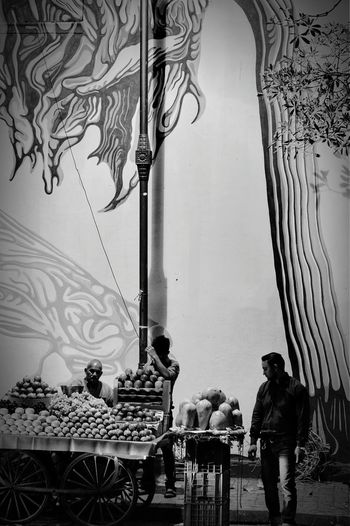 Lodhicolony St+art India Blackandwhite Photography Street Lamp Mural Art Fruit Vendor Indian Street Photography Street Photography Evening Light