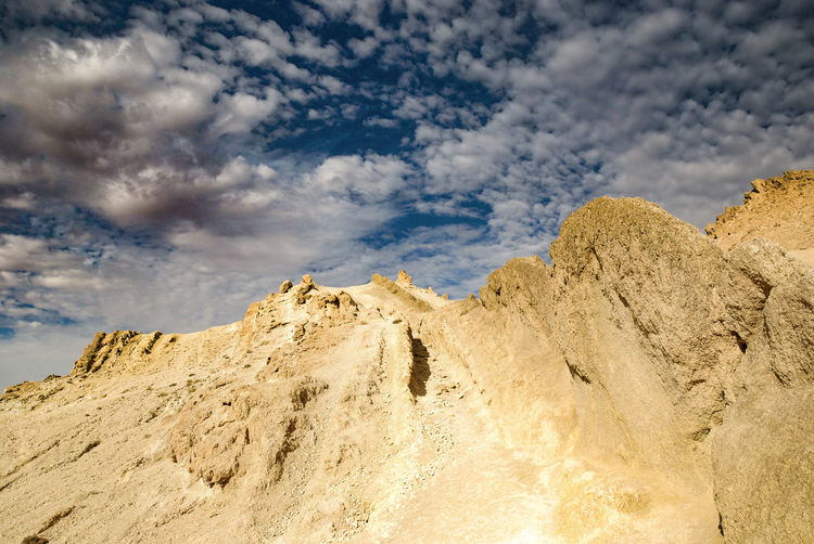 Tunis Cloud - Sky Sky Nature Scenics - Nature Beauty In Nature Tranquility Tranquil Scene No People Low Angle View Non-urban Scene Day Rock Mountain Rock - Object Environment Rock Formation Outdoors Landscape Land Sunlight Formation Mountain Peak Arid Climate Eroded Rosafrancomendoza