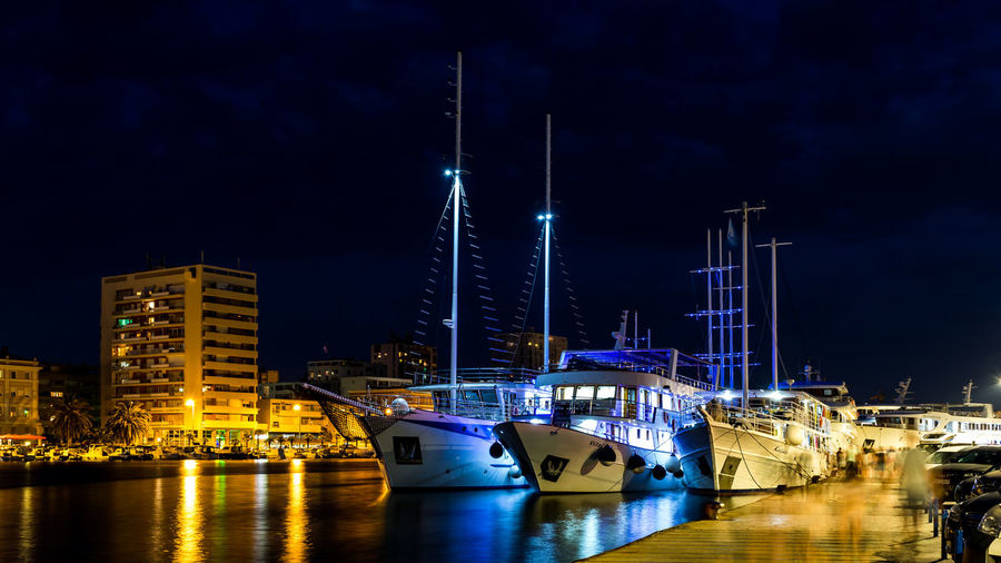 Architecture Building Building Exterior Built Structure City Harbor Illuminated Mode Of Transportation Moored Nature Nautical Vessel Night No People Office Building Exterior Outdoors Purple Reflection Sailboat Sea Sky Skyscraper Transportation Water Waterfront Yacht