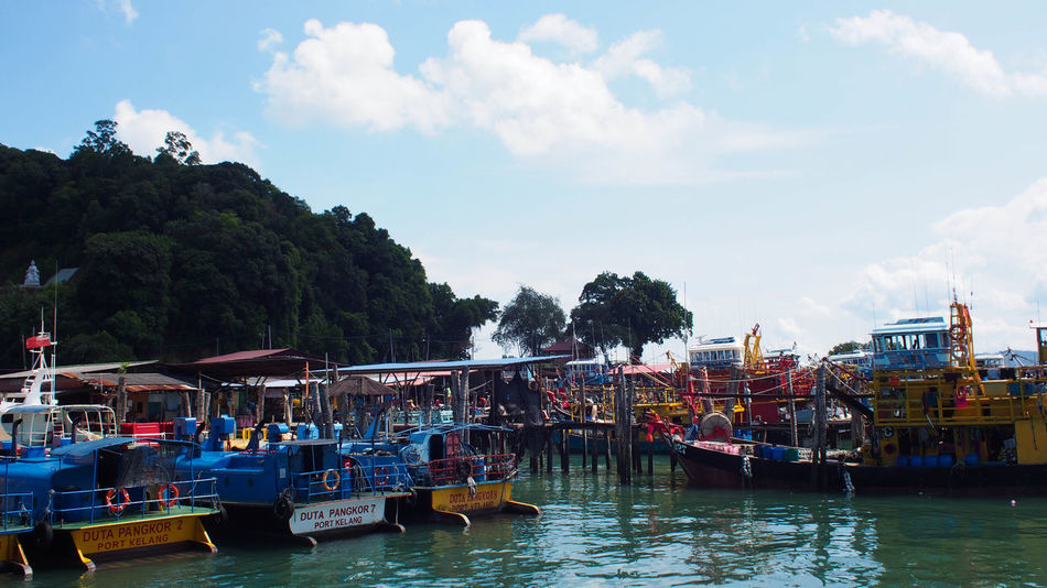 Pangkor Island Jetty, The main entrance to this island tour Ferry Islands Ocean View Pangkor Island Beauty In Nature Blue Blue Sky Boat Cloud - Sky Day Island Jetty Jetty View Malaysia Mode Of Transport Nature No People Outdoors River Sea Sky Tourism Transportation Tree Water