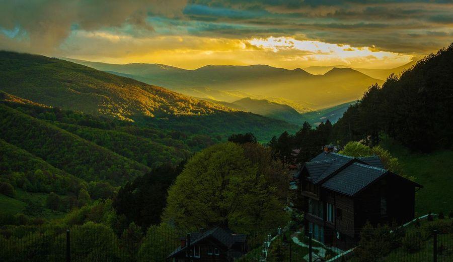 Sunlight touches mountain
