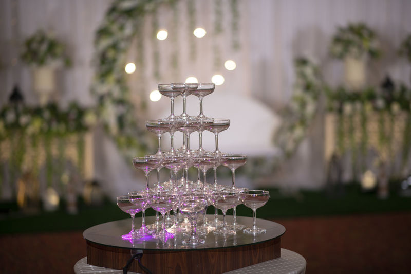 Close-up of stack of wine glasses on table