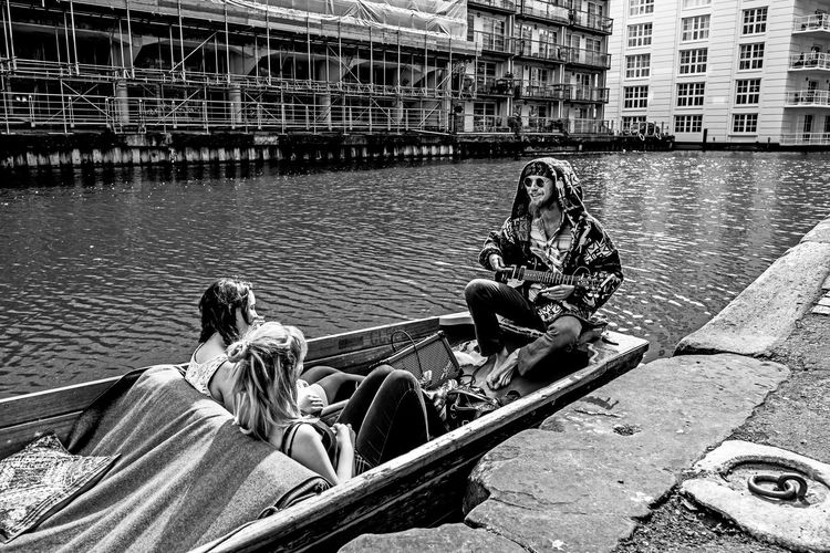 """""""The Singer"""" Architecture Bag Boat Building Exterior Built Structure Camden Town Casual Clothing City Day First Eyeem Photo London Mature Adult Outdoors River Sitting Streetphotography Transportation Water"""