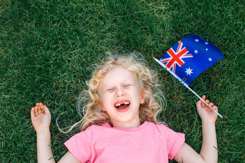 Caucasian girl holding australian flag. kid citizen celebrating australia day holiday
