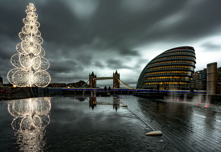 Xmas Christmas London United Kingdom England Center City Metropolis Capital Cities  Famous Place Europe No People Copy Space christmas tree Cold Dark Christmas Lights Tower Bridge  Monument City Hall Greater London Southwark  Dramatic Sky December Water Built Structure Sky Architecture Cloud - Sky Building Exterior Waterfront Nature Illuminated Night Reflection Office Building Exterior River Connection Travel Destinations Long Exposure Outdoors Skyscraper