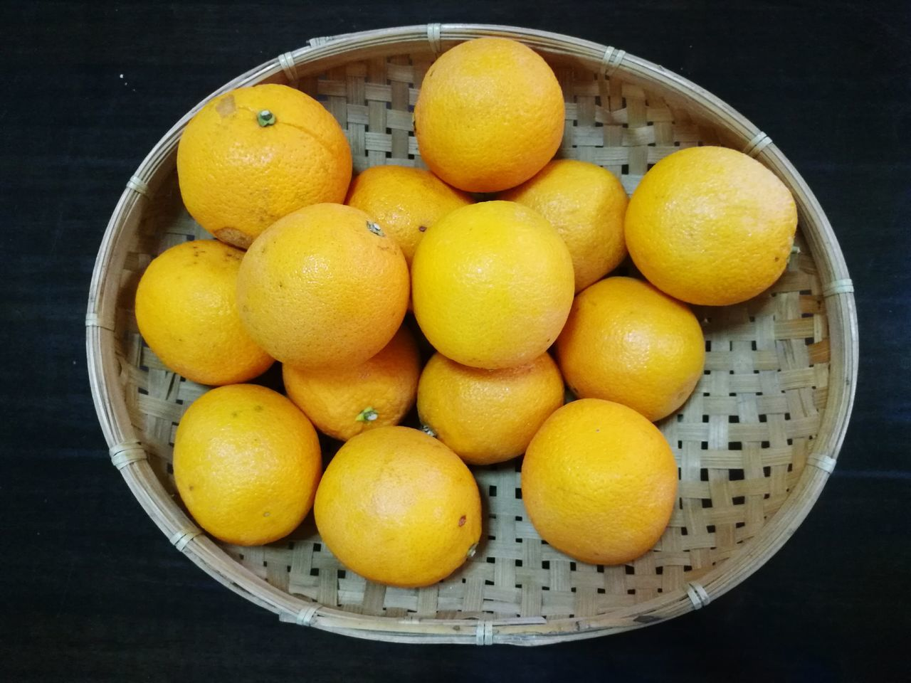 fruit, healthy eating, food and drink, freshness, food, citrus fruit, yellow, high angle view, basket, no people, table, close-up, indoors, day