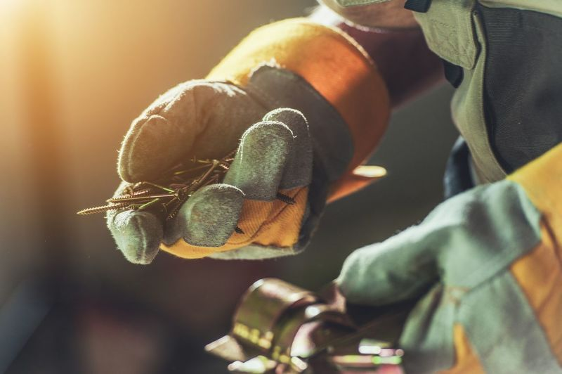 Construction Right Screws in Contractor Hands. Closeup Photo. Building Concept. Construction Construction Site Close-up Day Focus On Foreground Gloves Human Body Part Human Hand Insect Men Nature One Person Outdoors People Real People Tool