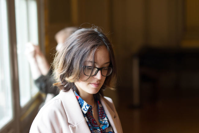 Black Hair Bokeh Day Focus On Foreground Glasses Headshot Museum Orsay Paris Person Portrait The Portraitist - 2016 EyeEm Awards Young Adult Young Woman