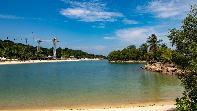 Sentosa Island Beach View Singapur Water Tree Sky Plant Beauty In Nature Scenics - Nature Tranquility Tranquil Scene Cloud - Sky Beach Nature Land Sea No People Day Idyllic Outdoors Growth Blue