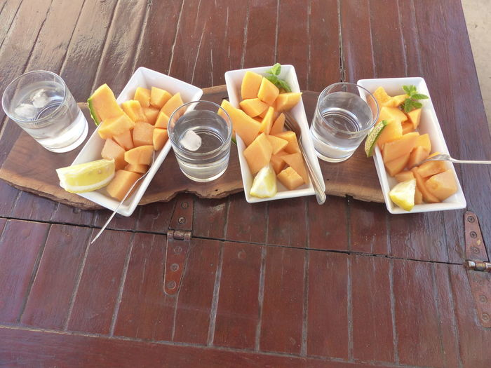 Day Drink Drinking Glass Drinking Water Food And Drink Freshness Fruit High Angle View Lemon Melon Mint No People Peace Of Melon Plate Ready-to-eat SLICE Table Wood - Material